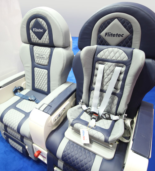 Gama Infant Safety Seat installed in a refurbished business class seat